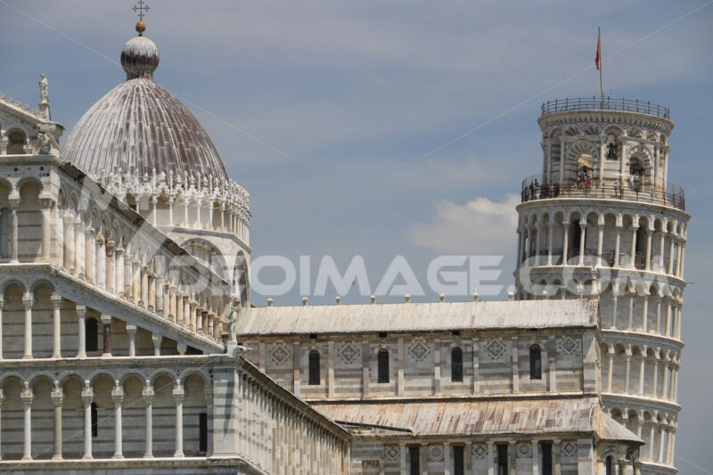 Piazza dei miracoli of Pisa. Cathedral, leaning tower of the Tuscan city. Blue sky with clouds. Photo stock - LEphotoart.com