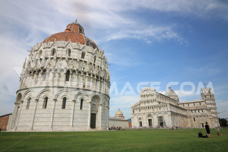 Piazza dei miracoli of Pisa. Cathedral, tower and baptistery of the Tuscan city. Blue sky with clouds. - LEphotoart.com