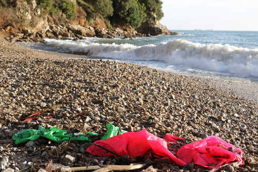 Plastic waste deposited from the sea on the beach after the storm. Liguria, Italy. - MyVideoimage.com