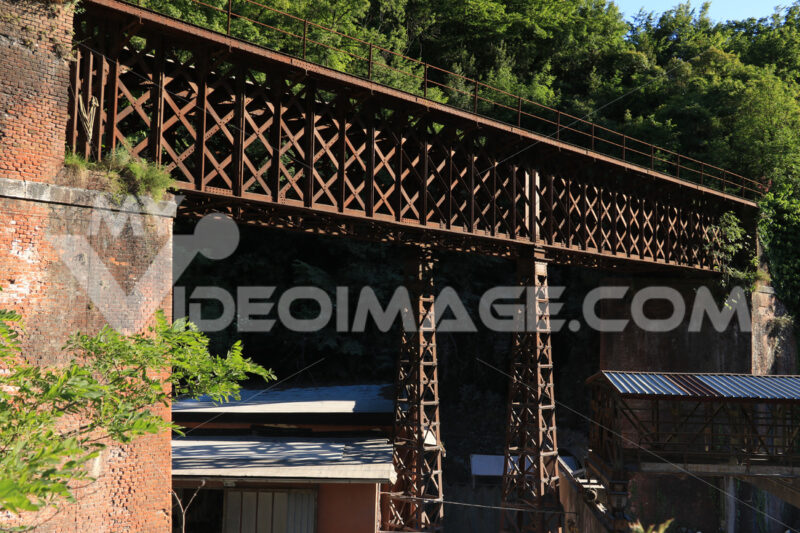 Ponte di ferro a Carrara. Iron bridge with reticular structure. The bridge was part of the - MyVideoimage.com | Foto stock & Video footage