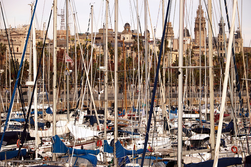 Port of Barcelona with moored sailing boats. Barcellona foto. Barcelona photo.