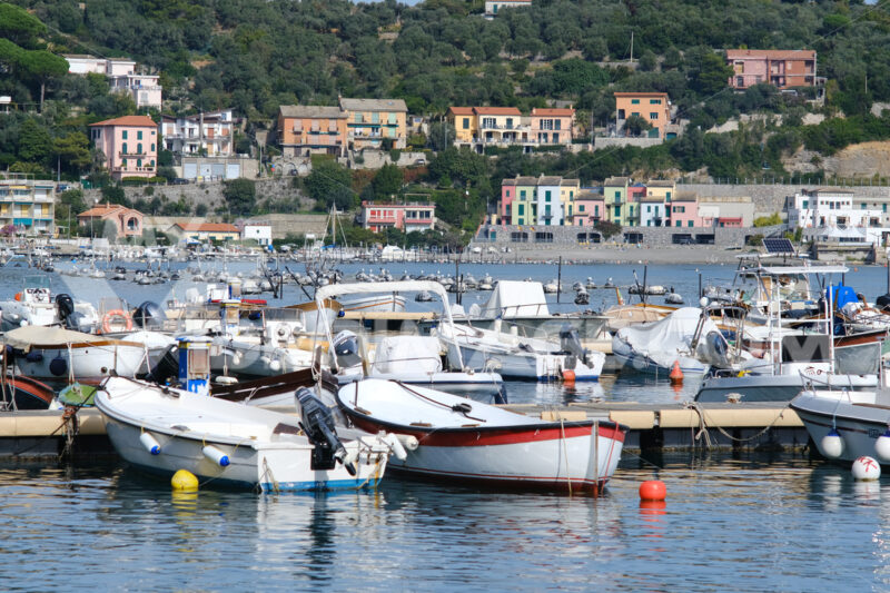 Portovenere marina with fishing boats moored. The village is frequented by tourists visiting the Cinque Terre. - MyVideoimage.com