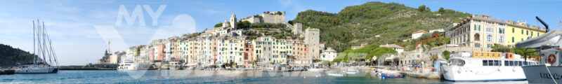 Portovenere village holiday destination near the Cinque Terre. Typical colorful houses, the harbor with boats and the church. - MyVideoimage.com