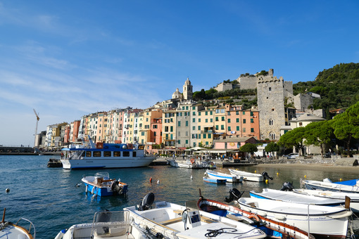 Portovenere village holiday destination near the Cinque Terre. Typical colorful houses, the harbor with boats and the church. - LEphotoart.com