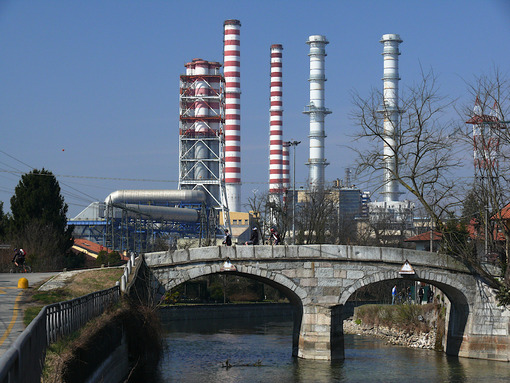 Power plant chimneys and a canal bridge in the foreground. - MyVideoimage.com