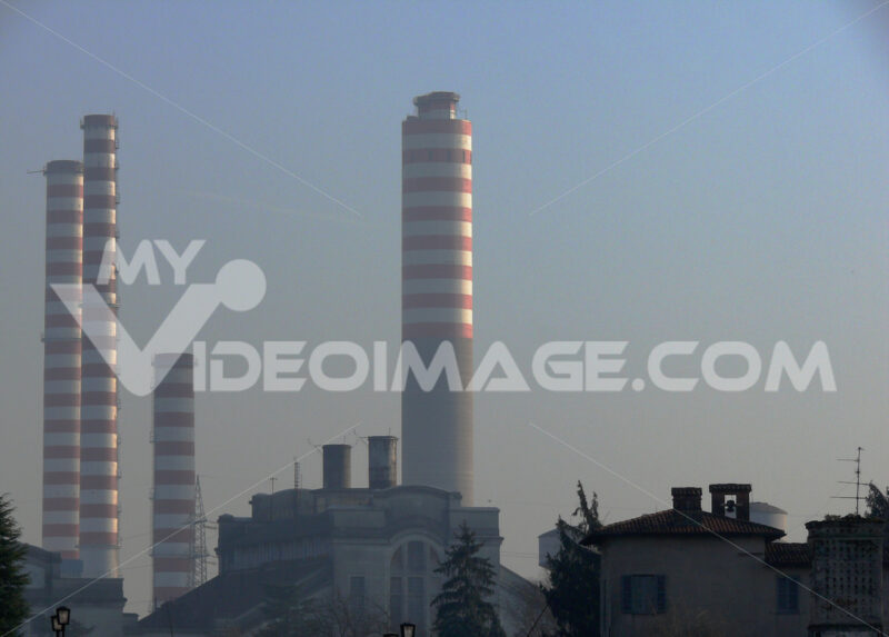 Power plant chimneys shooting at sunset. - MyVideoimage.com