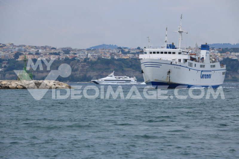 Procida ferry boat. Ferry boat in the Gulf of Naples. In the background, the seaside - MyVideoimage.com | Foto stock & Video footage