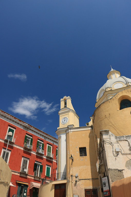 Procida island. Church with bell tower and buildings in the square on the Island - MyVideoimage.com | Foto stock & Video footage