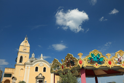 Procida. Church with bell tower in Procida. Blue sky with clouds., near N - MyVideoimage.com | Foto stock & Video footage