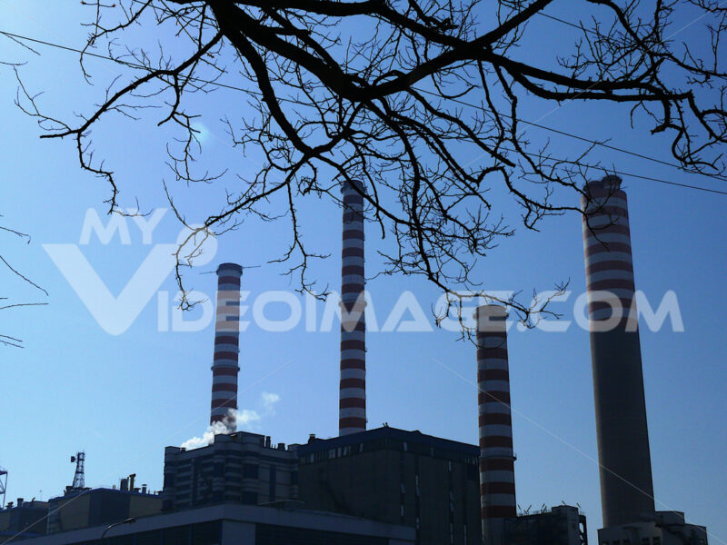 Profile of power plant with sky. - MyVideoimage.com