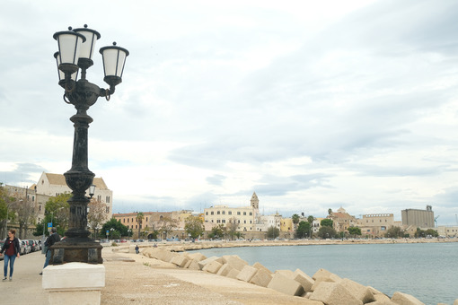 Promenade of Bari with the buildings of the old village. View of the port and the sea near the ancient Mediterranean city. Foto Bari photo.