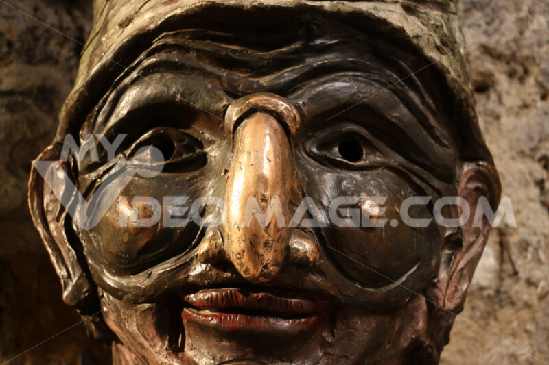 Pulcinella mask. Bronze sculpture of the typical mask of Campania and Naples. - MyVideoimage.com