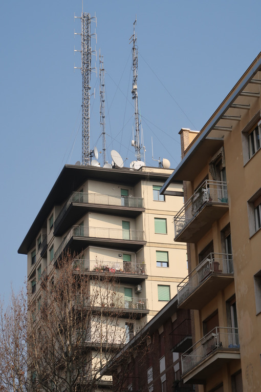Radio wave transmission antennas mounted on a building in the city center. - MyVideoimage.com