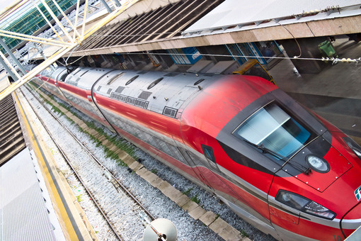 Red Arrow train at Rome Termini station. Top view with rails and shelters. Foto treno. Train photo.
