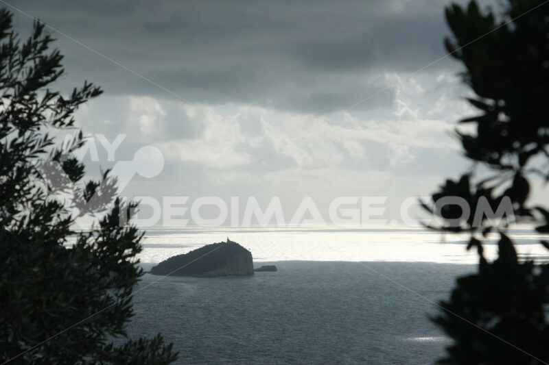 Reflections of light on the sea near the Cinque Terre in Liguria. Palmaria island with mountain and trees in the foreground. - MyVideoimage.com