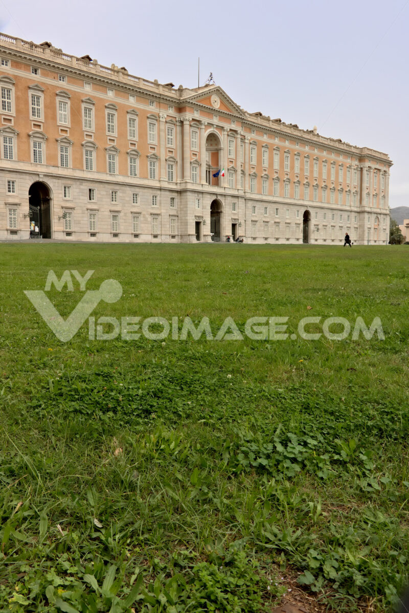Reggia di Caserta, Italy. Main facade of the palace with the green of the garden in the foreground. Caserta royal palace photo