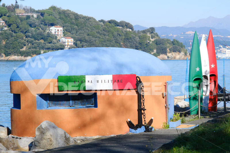 Reinforced concrete bunker converted for sports and recreational use. Canoes of the Italian Navy in Portovenere, near the Cinque Terre. - LEphotoart.com