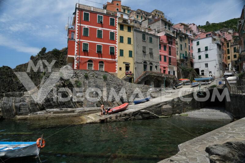 Riomaggiore to the Cinque Terre. Colored houses on the sea. Famous tourist destination. Coronavirus period.  Stock Photos. - MyVideoimage.com