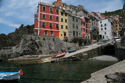Riomaggiore to the Cinque Terre. Colored houses on the sea. Famous tourist destination. Coronavirus period.  Stock Photos. - MyVideoimage.com