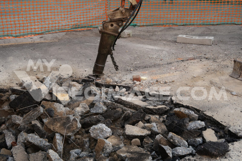 Road construction site. Demolition of the asphalt of a road with a jackhammer. - LEphotoart.com