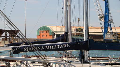 Sailboat of the Italian Navy anchored at the dock of the port of - MyVideoimage.com