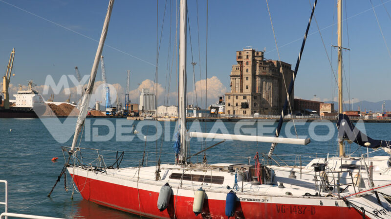 Sailboats anchored to the dock of the port. Abandoned warehouses - MyVideoimage.com