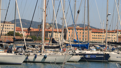 Sailboats anchored to the dock of the port. In the background th - MyVideoimage.com