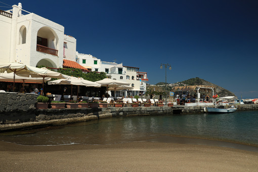 Sandy beach, sea and Sant'Angelo d'Ischia bay, near Naples. Foto Ischia photos.