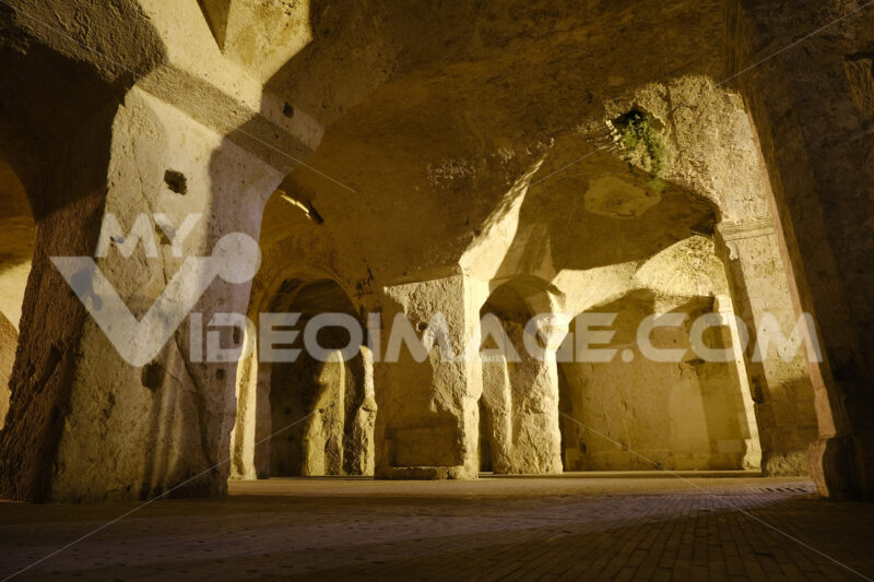 Sassi of Matera in Italy. Underground entry to the tanks called Palombaro illuminated by the lucenotturna of the sodium lamps. - LEphotoart.com