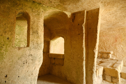 Sassi of Matera with arched ceilings and vaults. Ancient underground house dug out of the tufa rock. - MyVideoimage.com