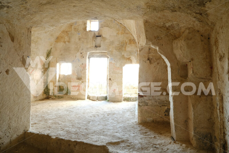 Sassi of Matera with arched ceilings and vaults. Doors and windows in an ancient underground house dug out of the tufa rock. - MyVideoimage.com