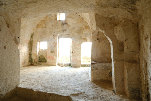 Sassi of Matera with arched ceilings and vaults. Doors and windows in an ancient underground house dug out of the tufa rock. - LEphotoart.com