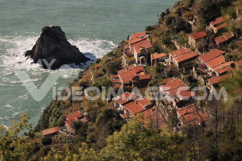 Schiara village seen from above. Near the Cinque Terre, La Spezia. Scoglio del Ferale and stormy sea. - LEphotoart.com