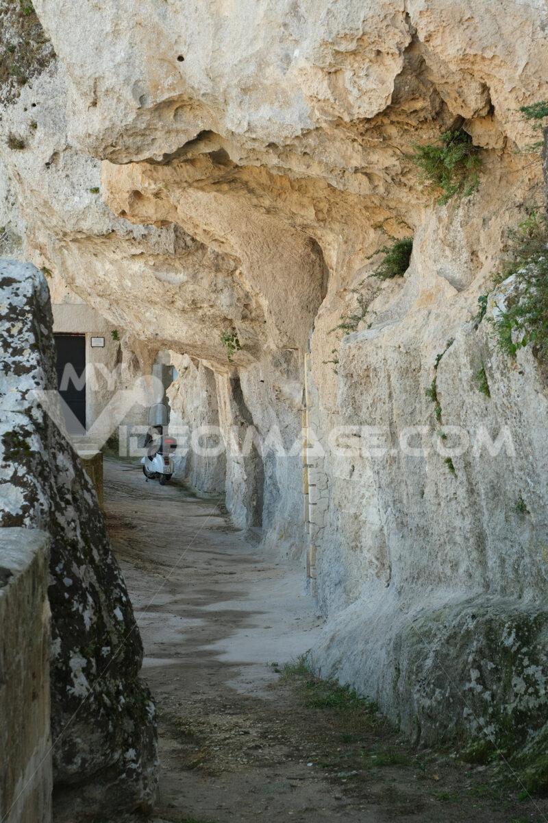 Scooter Vespa Piaggio parked in a cave of the Sassi of Matera in Basilicata. - MyVideoimage.com