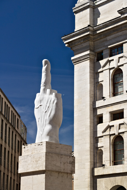 Sculpture of Cattelan's finger in front of the Milan Stock Exchange. The Milan Stock Exchange building in Piazza Affari with the work of Maurizio Cattelan. - MyVideoimage.com