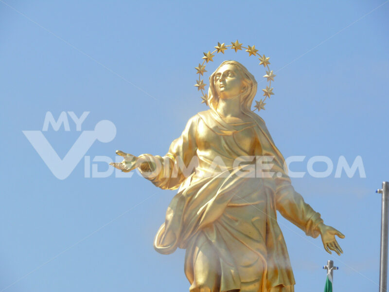 Sculpture representing the Madonna of the Milan Cathedral. Copy of golden statue. - MyVideoimage.com