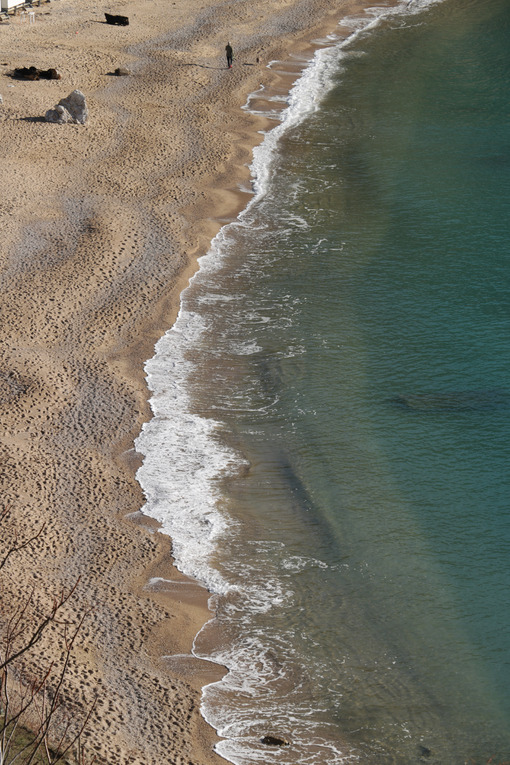 Sea and beach with golden sand in a top view. - MyVideoimage.com