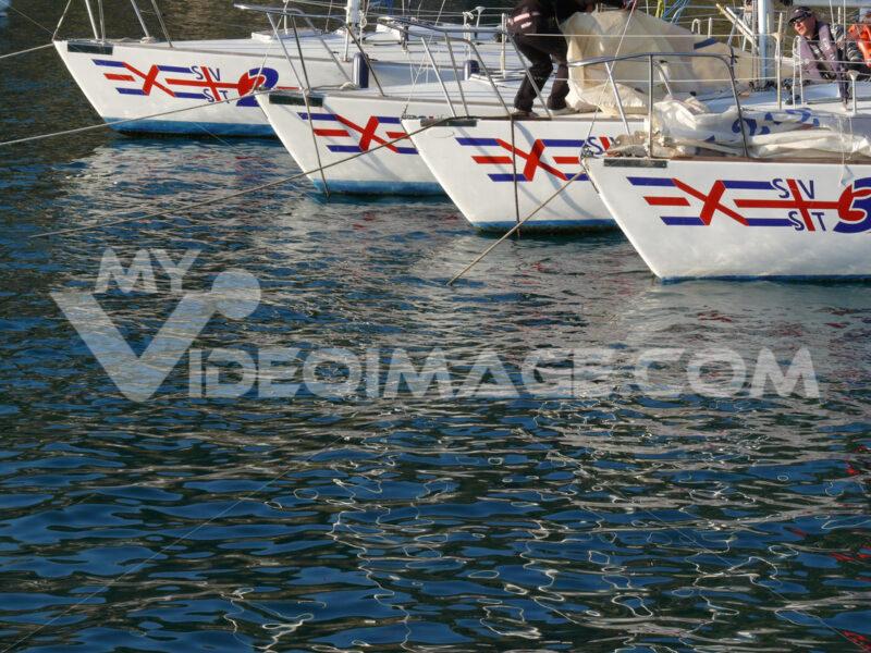 Sea school sailboats anchored in the port of Santa Teresa in La Spezia. - MyVideoimage.com