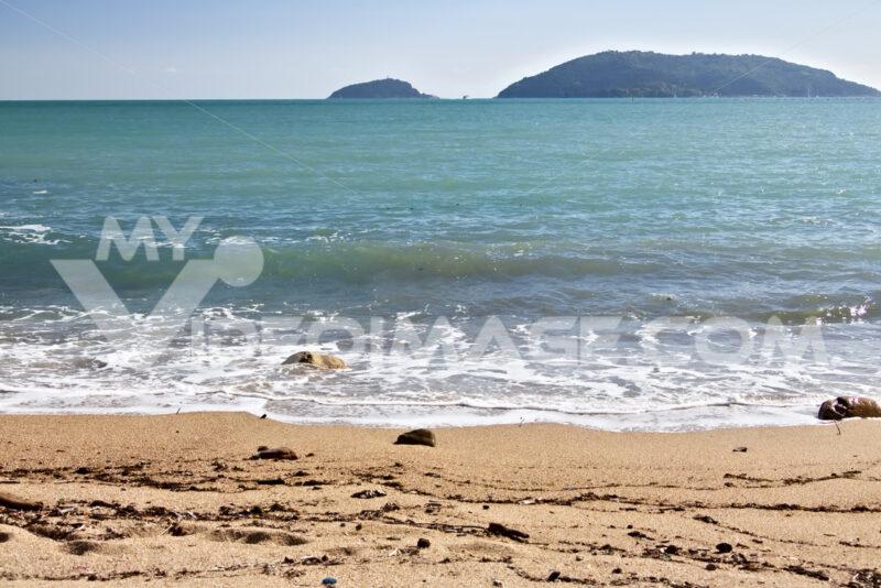 Sea waves break on the beach with stones. - MyVideoimage.com
