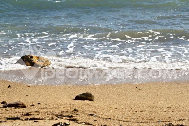 Sea waves break on the beach with stones. - MyVideoimage.com