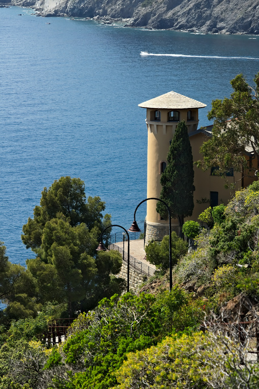 Seascape with house turret near the Cinque Terre. In the village of Framura a villa with a tower overlooking the blue sea and dense Mediterranean vegetation. - LEphotoart.com