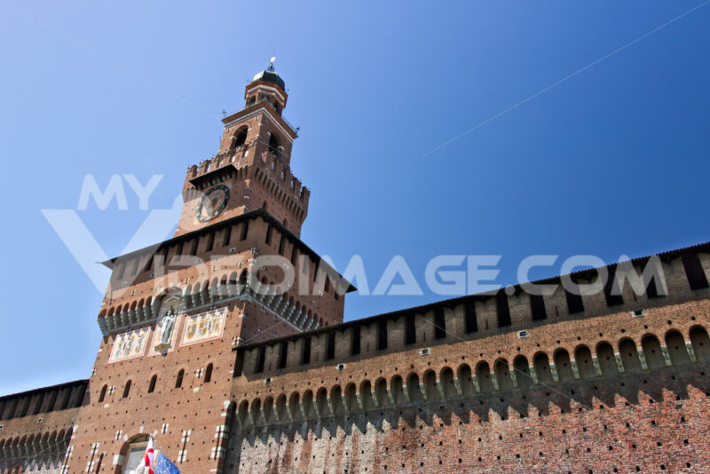 Sforza Castle in Milan. Tower with clock. The tower that overlooks the entrance to the walls of the castle of Milano. - MyVideoimage.com
