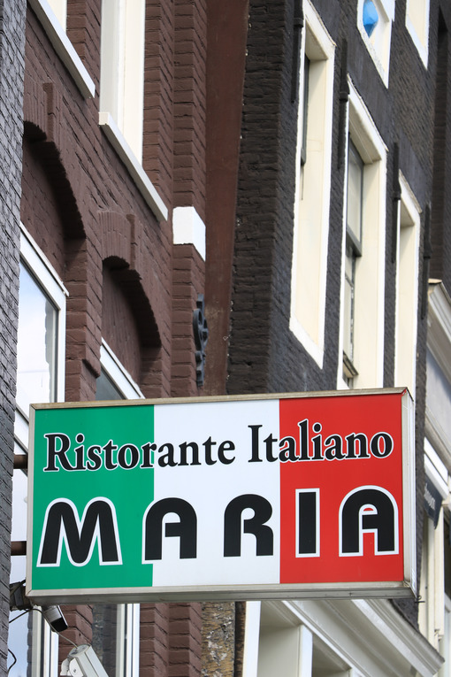 Sign of the Italian restaurant Maria with the green, white and red Italian flag. - MyVideoimage.com