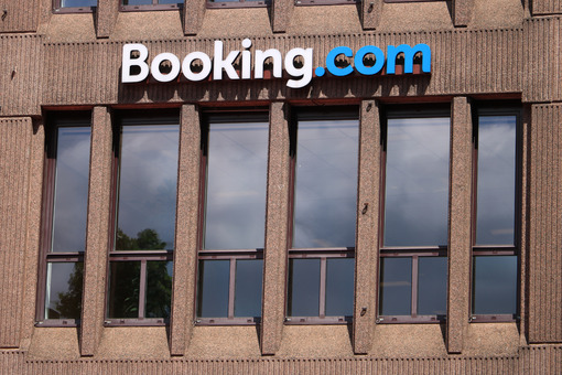 Signboard of Booking.com on the facade of a building. - MyVideoimage.com