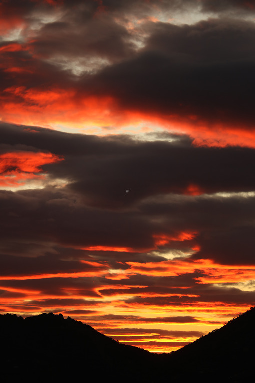 Sky with red-illuminated clouds by the sunset light. Gulf of La Spezia in Liguria. - MyVideoimage.com