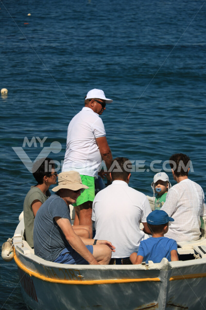 Small boat with tourists in the Mediterranean sea. Men, women an - MyVideoimage.com