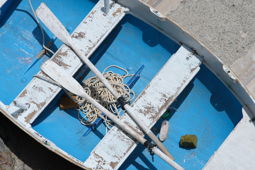 Small wooden fishing boat with oars. Photograph from above. Riomaggiore, Cinque Terre. - LEphotoart.com