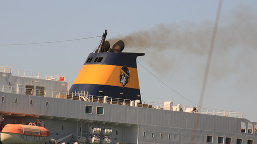 Smokestack of a large ship in the harbor. Black smoke comes from - MyVideoimage.com