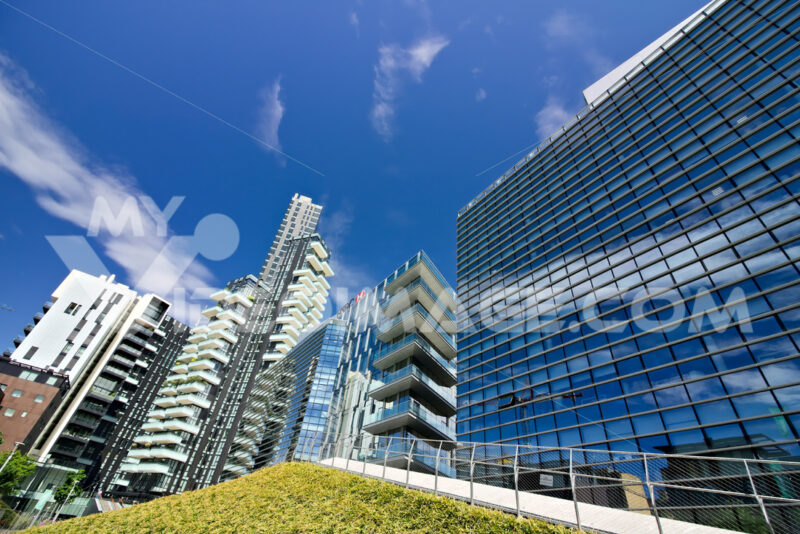Solaria tower with balconies and modern buildings with curtan glass facades.  Business district with skyscrapers and glazed buildings. - MyVideoimage.com