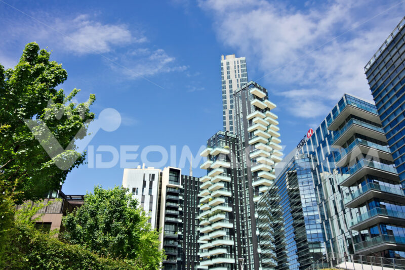 Solaria tower with balconies and modern buildings with curtan glass facades. Business district with skyscrapers and glazed buildings. Città italiane.
